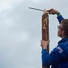 La précision à la rape à bois pour ce qui servira d'axe à l'installation des scouts de Marche en Famenne
