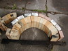 This shows number 2 arch bricks arranged in a barrel arch, no skewback needed, radius of arch is 11 inch, the arch sits on two bricks which makes the top of the arch at 16 inch in the firebox, when we put the arch in the firebox we were able to build it on simple cardboard cutouts of a 11 inch radius half circle,