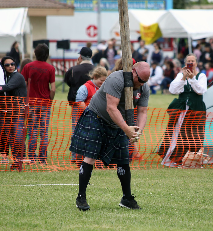 . Matt Murphy - Daily Democrat Doug Loud steadies the caber in preparation of a turn attempt during the 40-49 Masters competition Saturday at the Woodland Celtic Games and Festival.