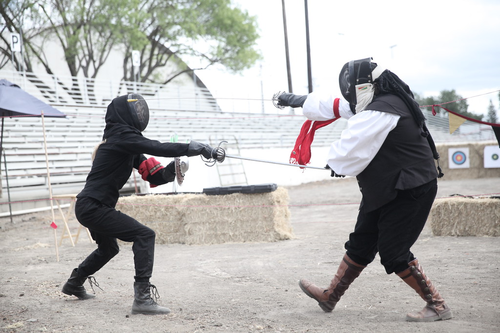. CUTTER HICKS � DAILY DEMOCRAT Fencing was on display inside the arena on the eastern side of the fairgrounds. Archery was also available for participants to try.