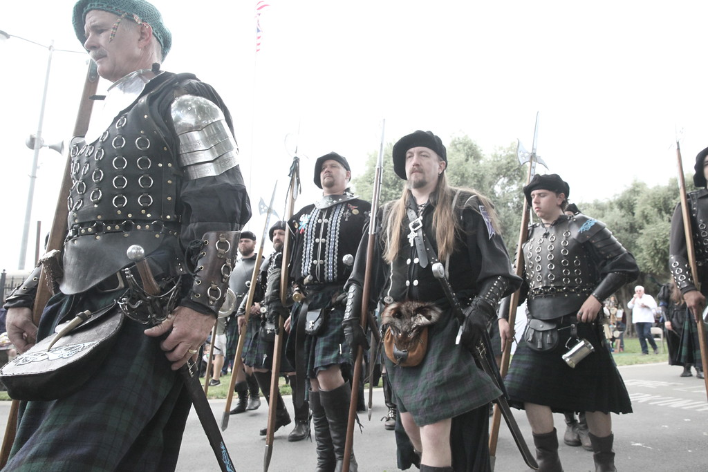 . CUTTER HICKS � DAILY DEMOCRAT The Scottish Halberdiers, a group of re-enactors, led the opening parade with spears and swords in-hand in front of hundreds on main street.