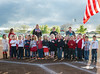 Woodland Christian School v. Foresthill, Girl's Varsity Softball action at WCS.<br /> Elementary School kids sing the Star Spangled Banner before the game.