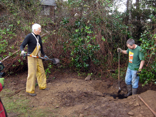 mixing in compost with regular dirt.