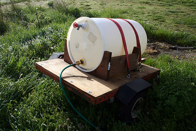 My new Water Buffalo.  55 gallons - 440 pounds.  Pulled by the truck.  I have to work out getting more water pressure in there though.  For now it is a gravity feed system.