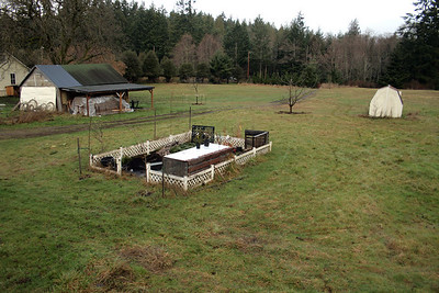 The Dirt Pit and Compost.  Here there is a composting bin, compost, mulch, top soil and future projects. Between here and the small yellow barn will all be future raised beds.
