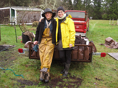 John & Monica enjoying a very brief relaxing moment after hard work and hard rain.  More hard work and hard rain to come.  Monica planted about 15 cedars.  :)   Thank you so much for all of your hard work and GREAT company during your stay.