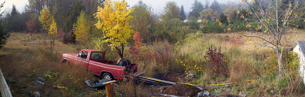 10/18/12  Coral Bark Maple.  A spliced together panoramic on my phone app makes the truck look broken here.    The only way to get something this large off of my truck is with the come-along.  Once in the hole it is a wrestling match between me and the tree for the right position.