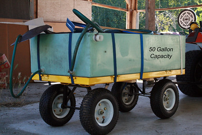 When planting on large pieces of property... never under estimate the amount of watering you will have to do.  This 50 gallon container I salvaged from an old RV.  At full capacity it weighs over 400 lbs.