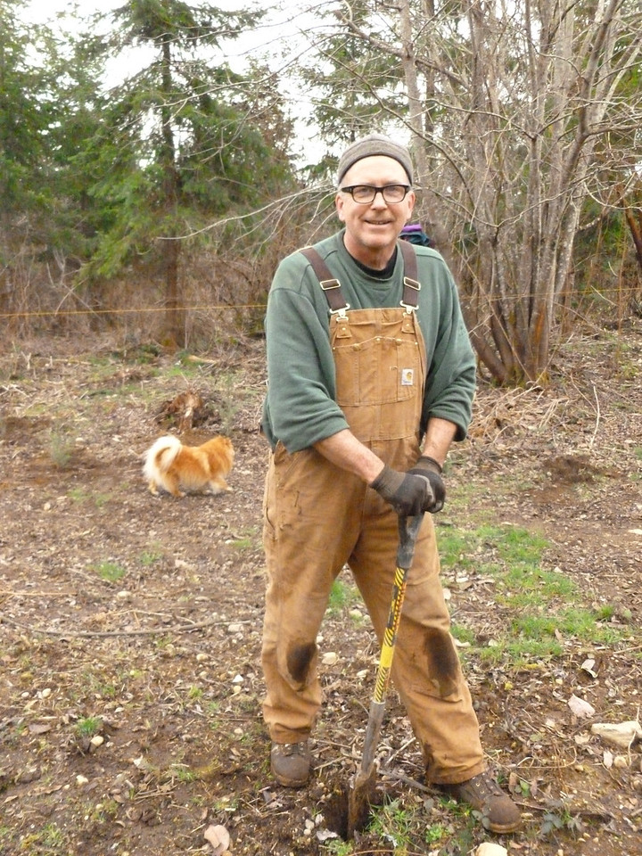 Bernie driving a wedge shape hole for a seedling.  March 2, 2013
