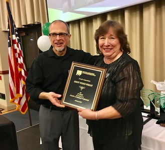 JIM SMITH - DAILY DEMOCRAT Outgoing Chamber President Kevin Cowan recognizes Chamber Executive Director Kristy Wright for her 35 years of leading the organization.