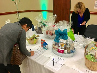 JIM SMITH - DAILY DEMOCRAT People bid on items during a silent auction held at the 87th annual Chamber of Commerce Installation Dinner.