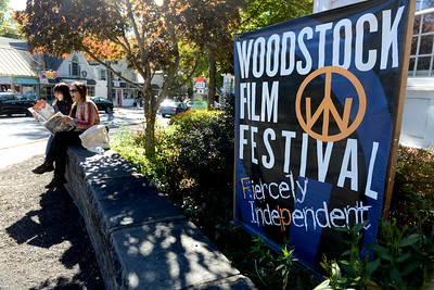 Tania Barricklo-Daily Freeman  Nurith Spector, left, and Sophia Preza, both of Woodstock, look over the Woodstock Film Festival schedule Friday outside of WAAM ( Woodstock Artist Association Museum) in the center of Woodstock  as they pick out what they want to see. The friends, who purchased full festival passes, are looking forward to, amongst other things, a fillm titled The Last  Dalai Lama?