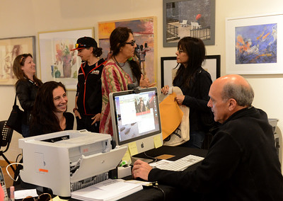Tania Barricklo-Daily Freeman                      Sam Kandel , right, the badgemaster for the Woodstock Film Festival, registers Erica Saleh of New York City whose husband Logan Hill is a juror for the festival. Registration for those invloved in the festival is located at hospitality, located at WAAM Woodstock Artist Association Museum).