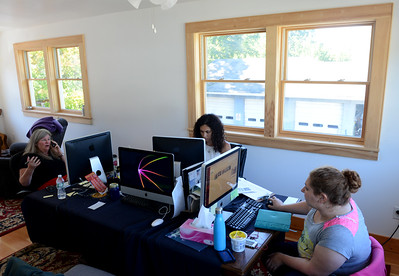 Tania Barricklo-Daily Freeman  Woodstock Film Festival  press staff in the upstairs office at the festival headquarters on Rock City Road in Woodstock. From left are: Press Director Deb Medenbach, Deputy Press Director Kaela Garrett , and Press Assistant Rachel Wells.
