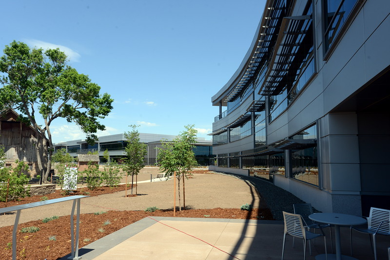 Woodward Inc.'s new campus in north Fort Collins, shown Tuesday, June 7, 2016, features its world headquarters building, right, Industrial Turbomachinery Systems facility, center, and the old barn and milk house from the original Coy-Hoffman homestead, left. (Photo by Craig Young / Loveland Reporter-Herald)