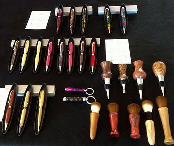 Pens, Keychains, Wine Bottle Stoppers and Make-Up Brushes in wood and acrylic.