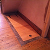 Cellar hatch door closed.It is flush with the existing floor level and only requires a single finger pull to open due to the gas strut system.