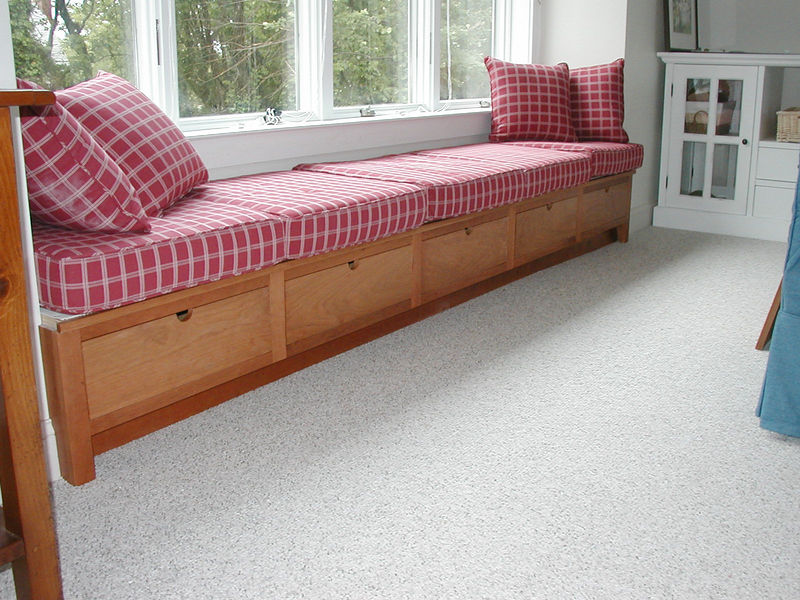 Window seat with full extension drawers below.