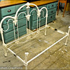 Wrought Iron Headboard and footboard with shortened bed frame.