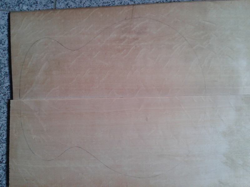 This bear claw figured spruce will become the sound board for a flattop guitar based on the Eastman El Rey O outline. The Eastman is an archtop but I have this spruce and some wenge suitable for a flattop and, hey, I like the El Rey's proportions. (The pink colour is just poor photography.)