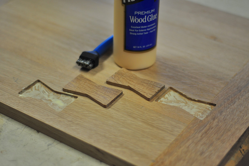 A spot of glue spread evenly with a silicone brush will secure the inlays.