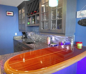 "Nautical blue kitchen design with surfboard bar top: Boardwalk Builders Kitchen & Bath Remodelers 4'3"" x 18"" Catalina bar table top www.invitinghome.com www.woodensurfboards.com"