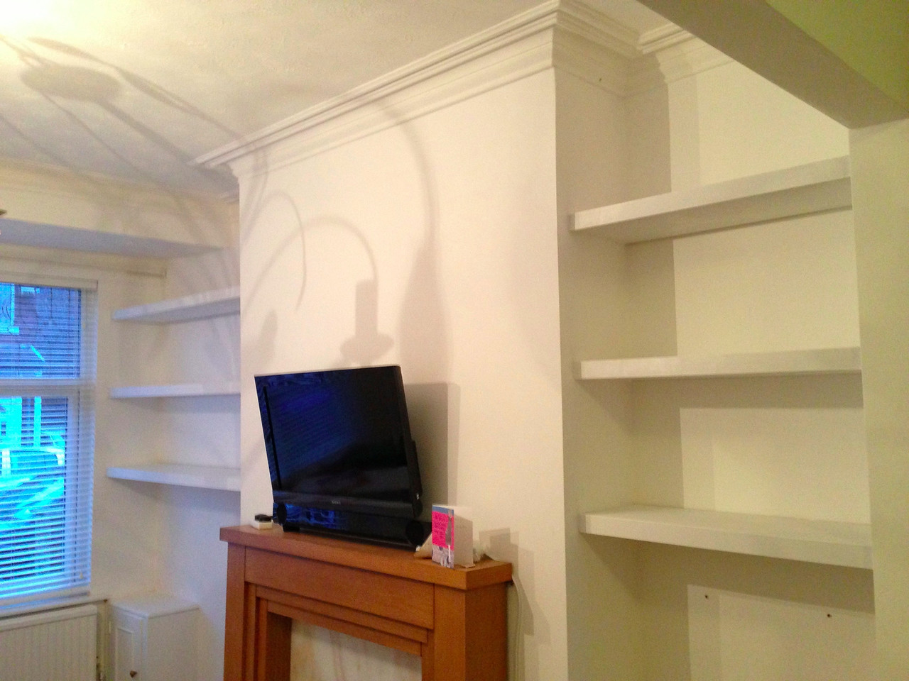 "Floating shelves in Alcoves custom made by  <a href=""http://www.harrisonwoodwork.com"">http://www.harrisonwoodwork.com</a>."