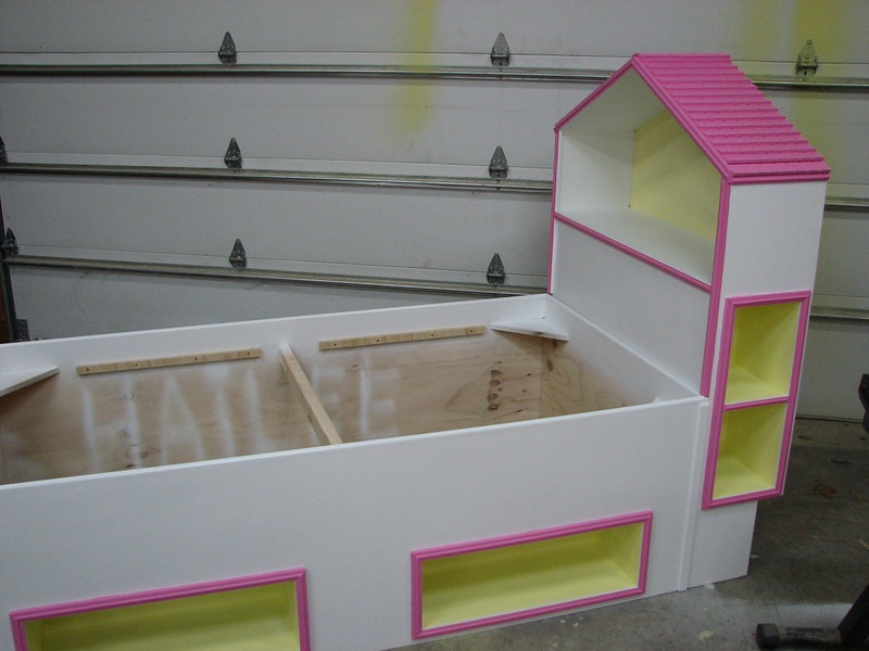 Kenton Schultz built this Princess bed for his grand daughter. Built of plywood with beadboard for the roof top.