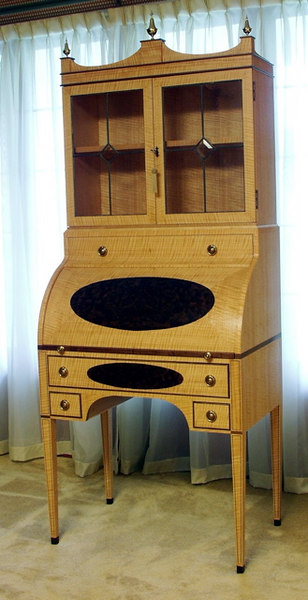 Bill Hopkins (item 1 view 1) built this beautiful cylinder-top writing desk, circa 1792, that won Best of Show in the Woodworking - Creative Crafts Division at the 2004 Iowa State Fair.