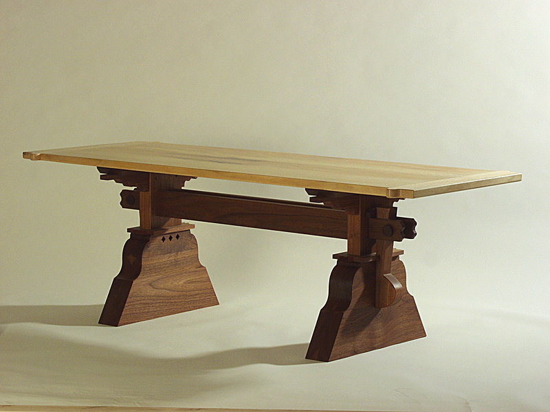 "Dave Grieve (view 1) designed and built this Tressel Table for the Women's Resource Center  ""Sit On It Auction"".  The under structure is Walnut and the top is Sycamore."