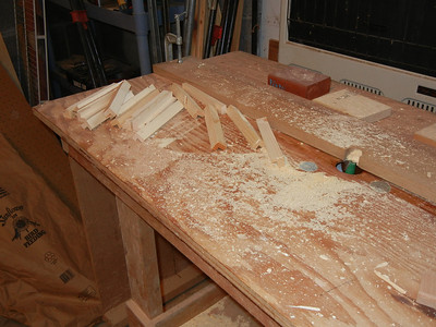 Before gluing up the boxes, I used the router to make a bunch of square braces.