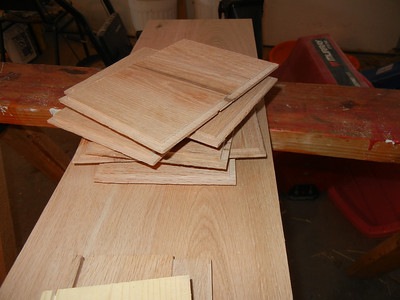 I glued up some of the boards to form wider planks, and planed them thinner for the tops and bottoms. I routed tongues on the route.r table for the tongue-and-groove fittings