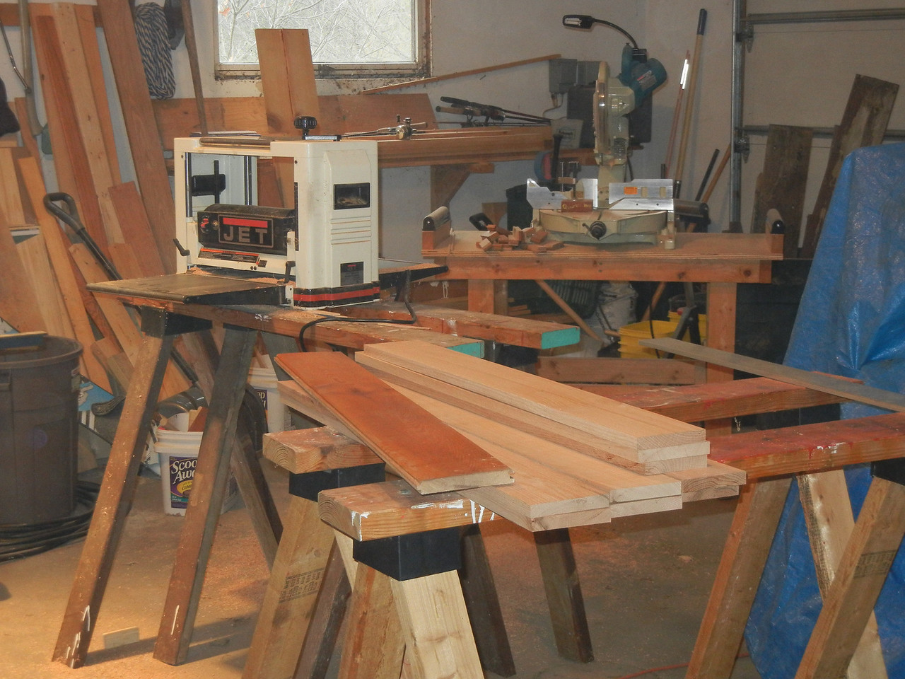 I trimmed the wainscoting on the table saw, and planed it into nice square boards. For free! Well, except for the cost of the tools.