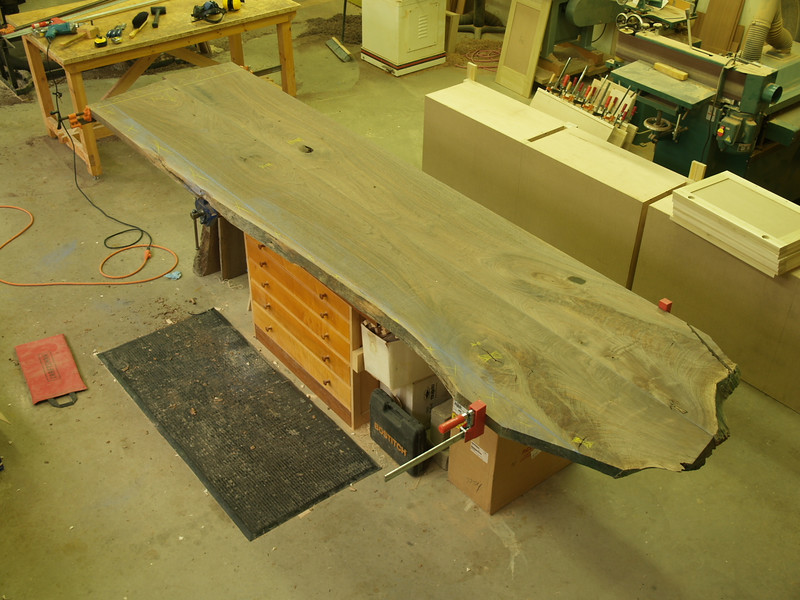 "Here's an overhead shot of the table.  The planks have been planed (to 1-7/8"") , the back edge has been cut straight to go against the wall, and they have been joined together down the middle. There is some awesome crotch figure on the right end."