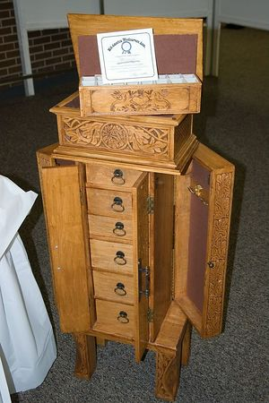 This chest and jewelry cabinet were made by one of the carvers for his daughter.