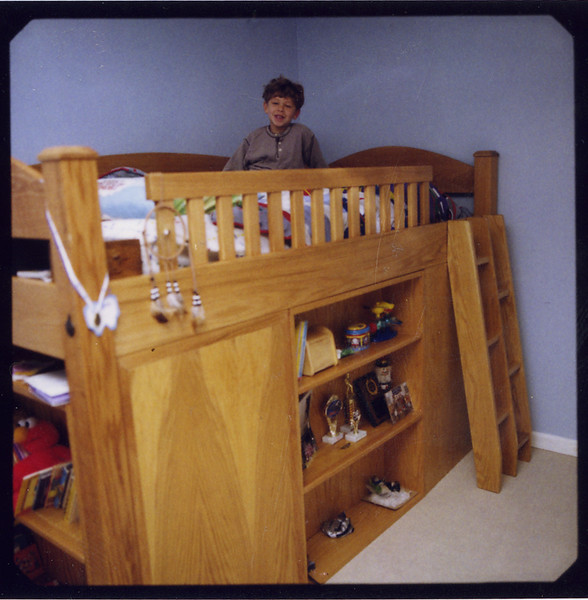 Dan's Secret Compartment Bunk Bed<br /> Solid Oak<br /> Two bookshelves<br /> Alternating Tread Ladder<br /> Secret Compartment<br /> Custom Design