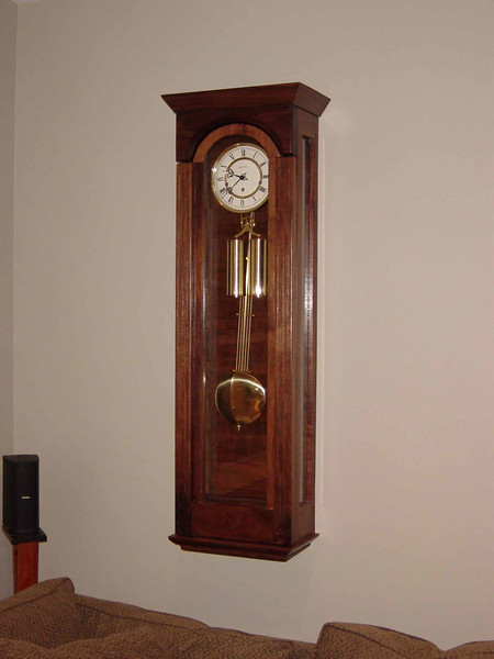 Wall Clock<br /> Solid Walnut, Mahogany Soundboard, and Glass.  Full Westminster Chimes movement.