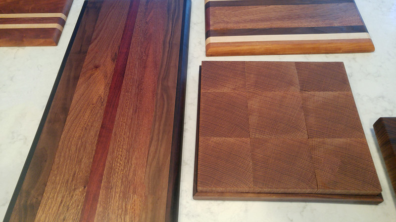 A large serving board if walnut, mahogany, and bubinga (left).  A chopping block with oak butcher block in a walnut trim (right).
