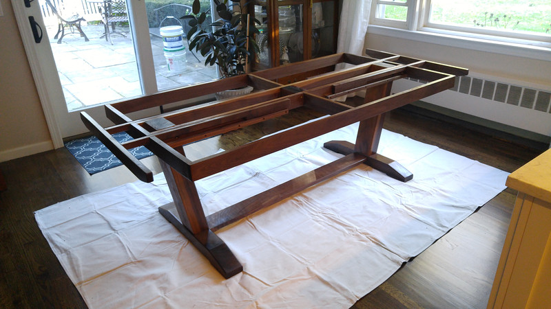 End table slide outs provide support for end leaves that extend the table to support 4 additional diners.
