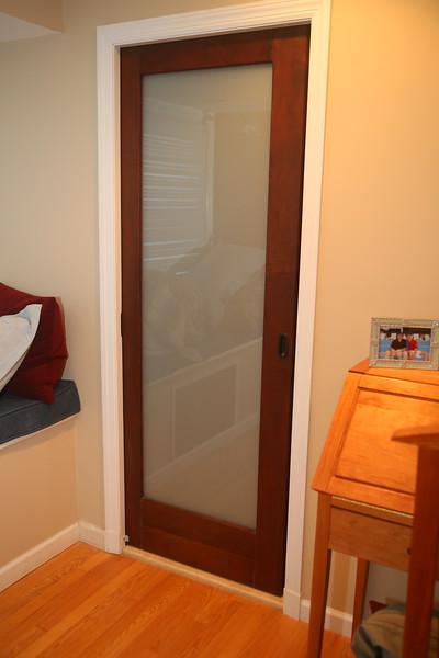 Pocket Door<br /> Solid Sapele <br /> Translucent Laminated Glass<br /> $900 / Door