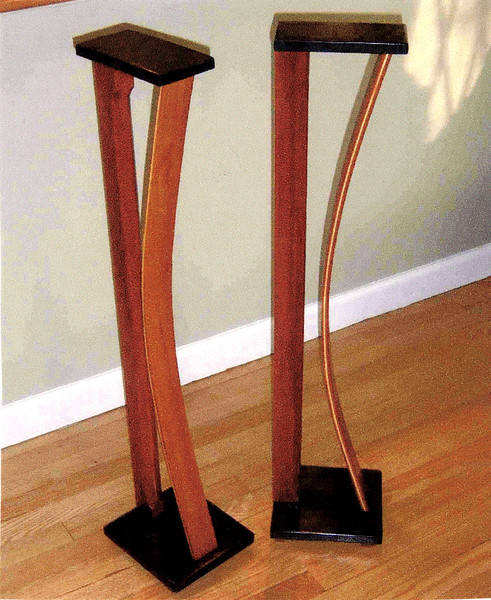 Speaker Stands<br /> Solid Mahogany and Maple Lamination<br /> Wenge Top and Bottom<br /> Hidden wire chase through back support<br /> Clear stain, Lacquer, and Wax finish<br /> $750 / pr.