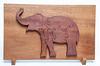 Mahogany puzzle tray and Mahogany elephant with dark crimson stain. Cut from a single piece of mahogany.