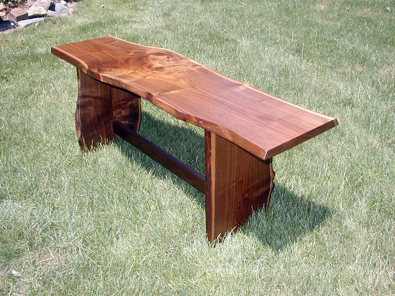Natural-edge walnut bench, with through, wedged tenons.