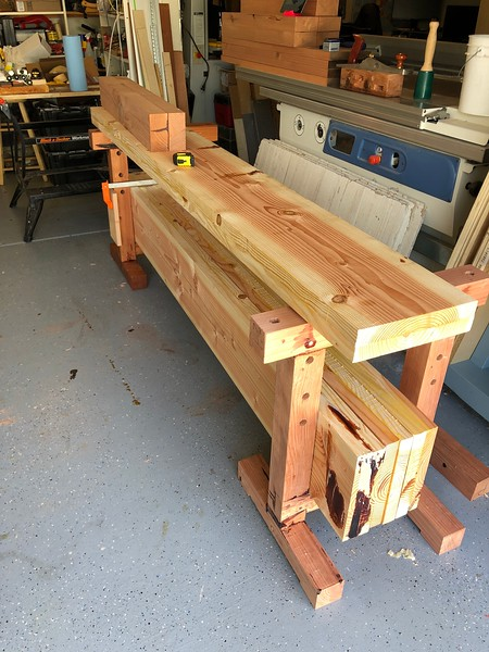 "I have not cleaned up nor finished the second saw horse as I wanted to get on with my bench. Yes, those are badly laminated douglas fir 2x12's with some fill. The blank on top is a 5"" square leg for the bench."