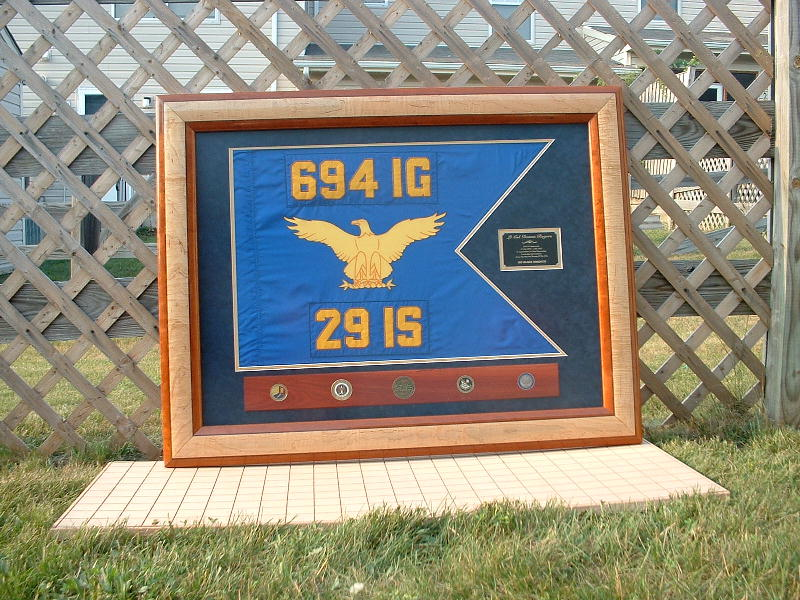 This was a going away gift from our squadron to an outgoing commander.  The 694th IG went away shortly before her change of command.  We framed the old guidon, since it was retired.  The frame features cherry, peruvian walnut, and curly maple.  The coin rack is bloodwood.