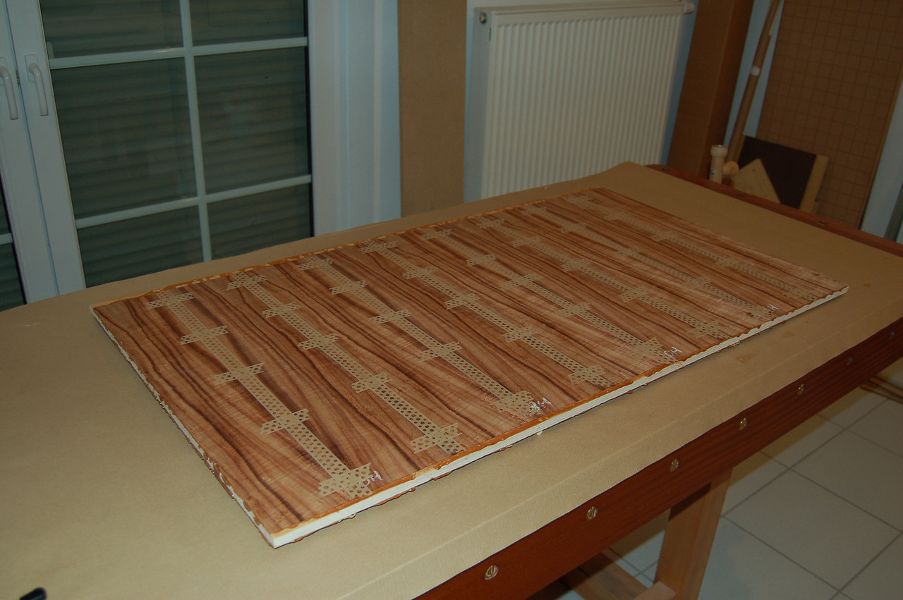 Here is the koa side of the center headboard panel after it came out of the press.