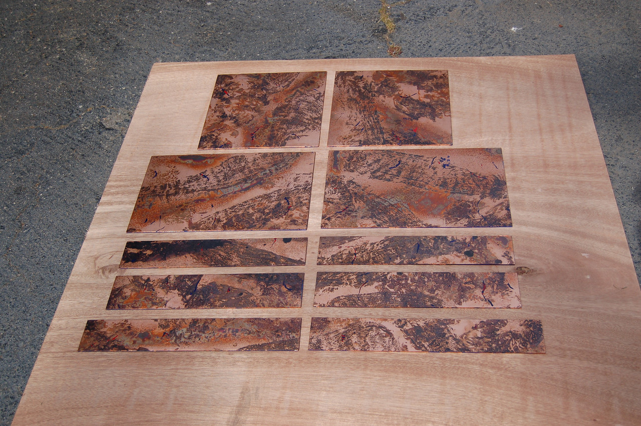These panels are actually just masonite which are painted with japan paints and guilded with copper leaf.  I used mild acids to apply a cold patina, and sealed them with shellac.