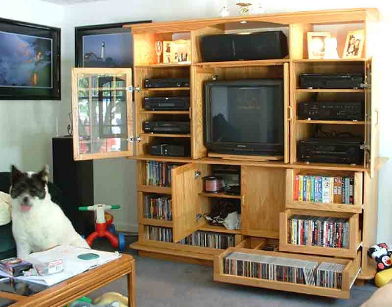The project that got me started.  I got into woodworking full-bore when I couldn't find an entertainment center I liked well enough to buy.  I built a matching aquarium stand first, just to get my feet wet.  This piece was built in 2000, and I sold it in 2005, when I outgrew it (as in upgraded to a much larger TV).