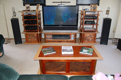 Here is the furniture I built to replace that Oak entertainment center.  The woods I used are mahogany, birdseye maple, quilted mahogany veneer, and a little bit of peruvian walnut.  I also incorporated copper pipe with a hot patina, and notan guilded copper panels with a cold patina treatment.