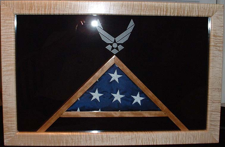 This box is curly maple and cherry as well.  I added the glass etching of the Air Force logo and a strip of cherry around the inside of the frame.